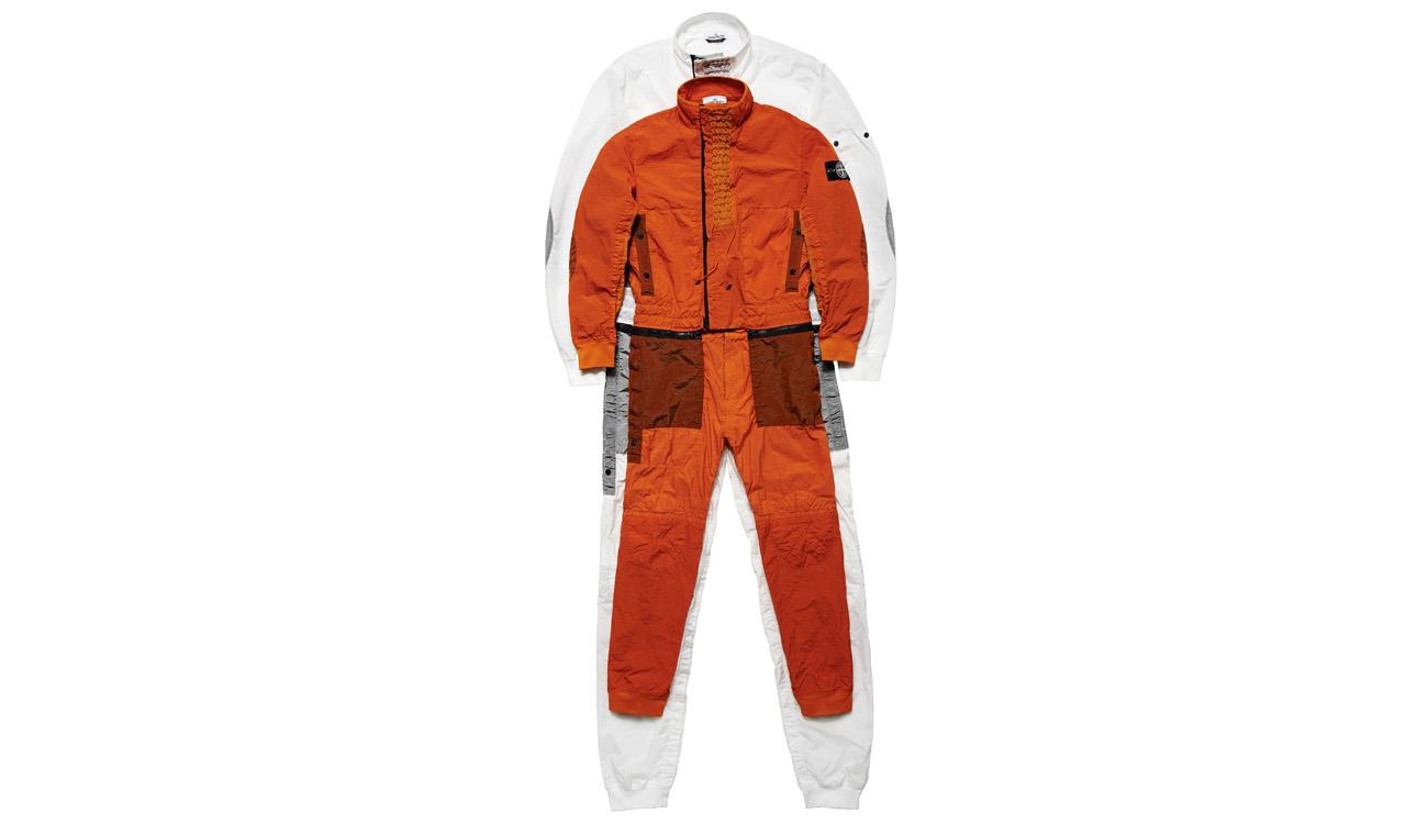 Orange jumpsuit laid on top of white jumpsuit.