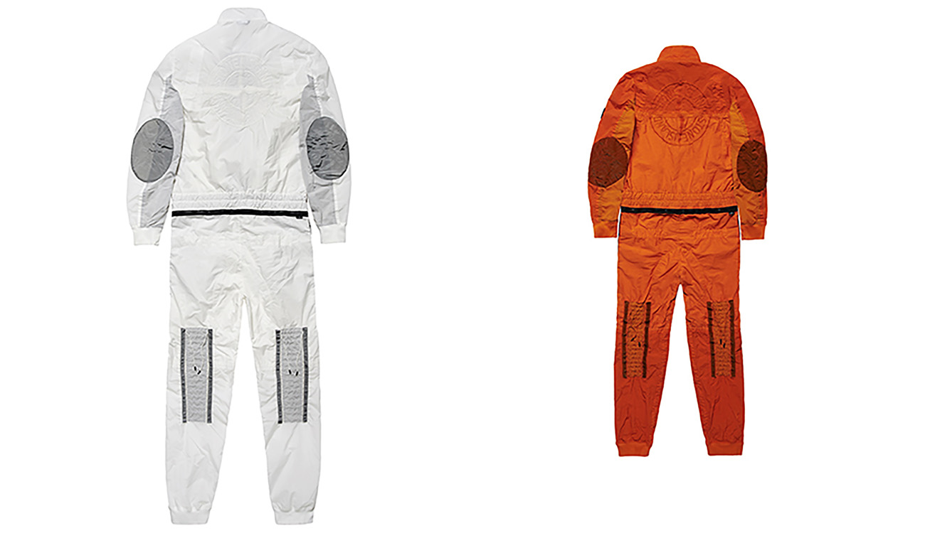 Back sides of white jumpsuit and orange jumpsuit both with Stone Island compass logo on the back.