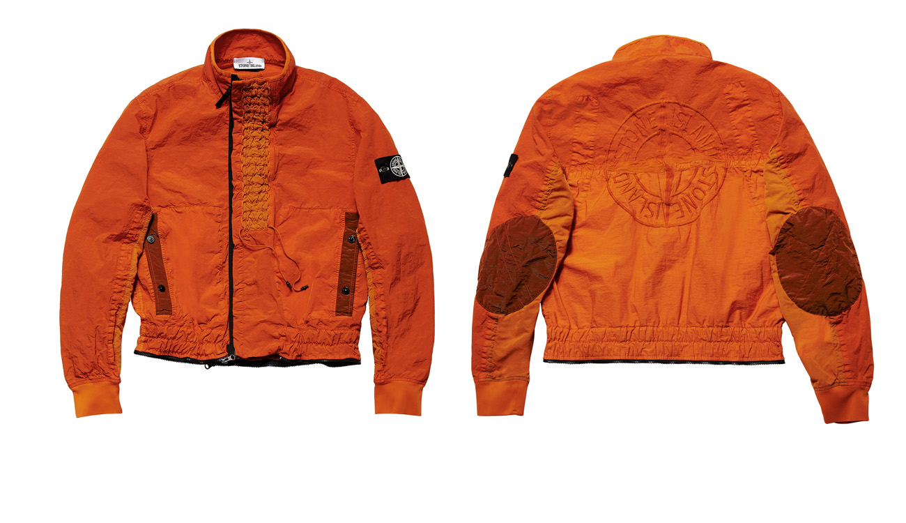 Front side and back side of orange, jumpsuit top only with elbow patches and the Stone Island compass logo on the back.