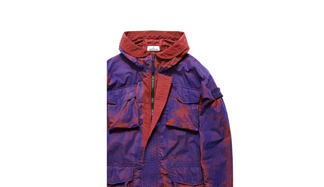 Jacket with hood down revealing concealed zipper closure.