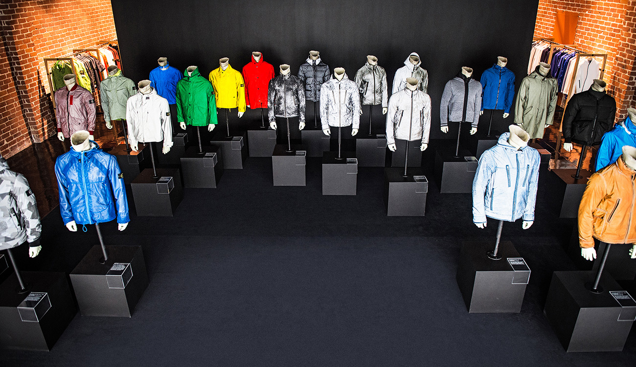 Lots of mannequins wearing jackets in different colors and styles.