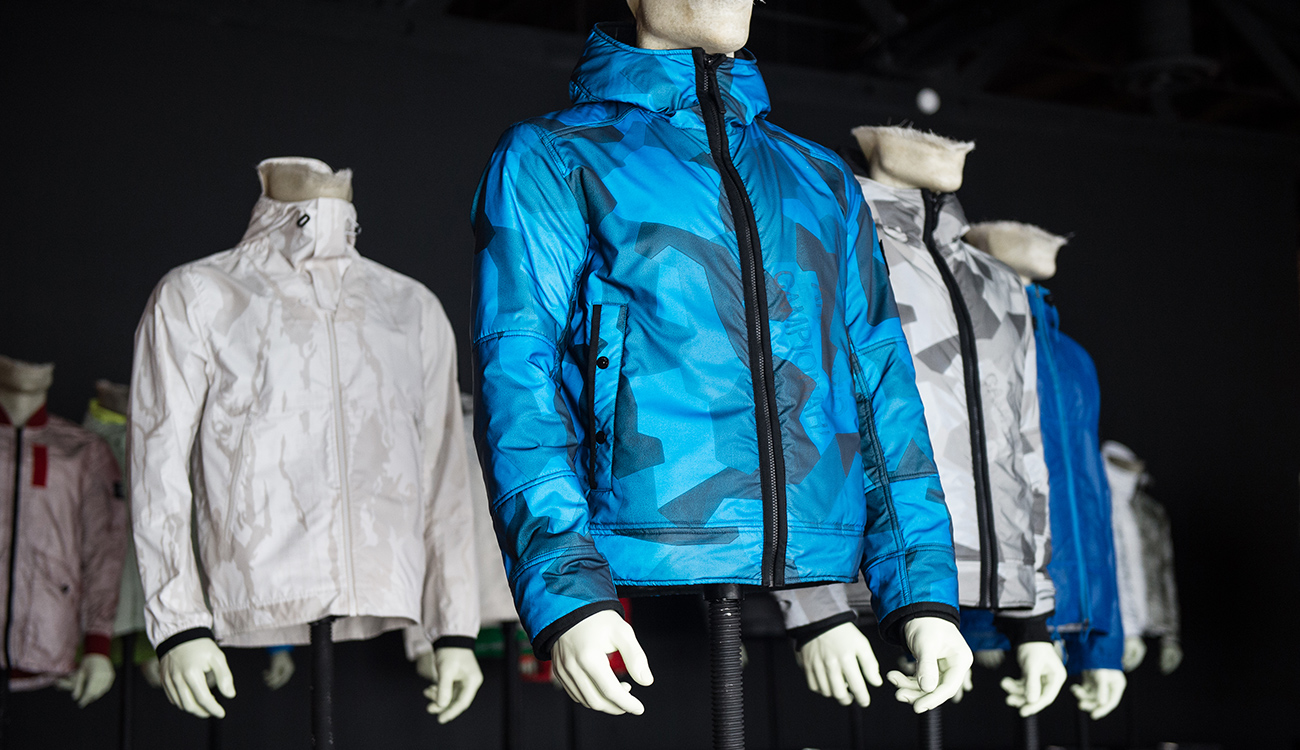 Mannequins wearing jackets in different colors and styles, all with a digital camouflage print.