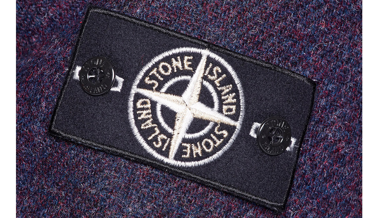 The detachable Stone Island compass badge on Harris Tweed with Polymorphic Ice fabric.