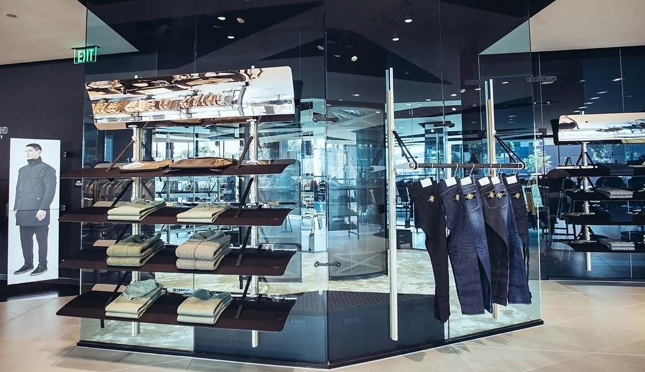 Merchandise displayed on freestanding, blue, glass panels.