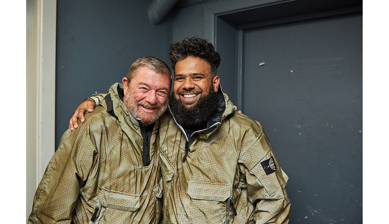 CEO of Stone Island, Carlo Rivetti with a friend laughing both wearing anoraks from the Prototype Research Series 1 and both smiling.