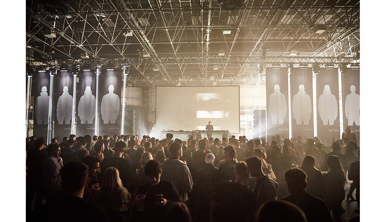 Interior shot of club in large industrial space.
