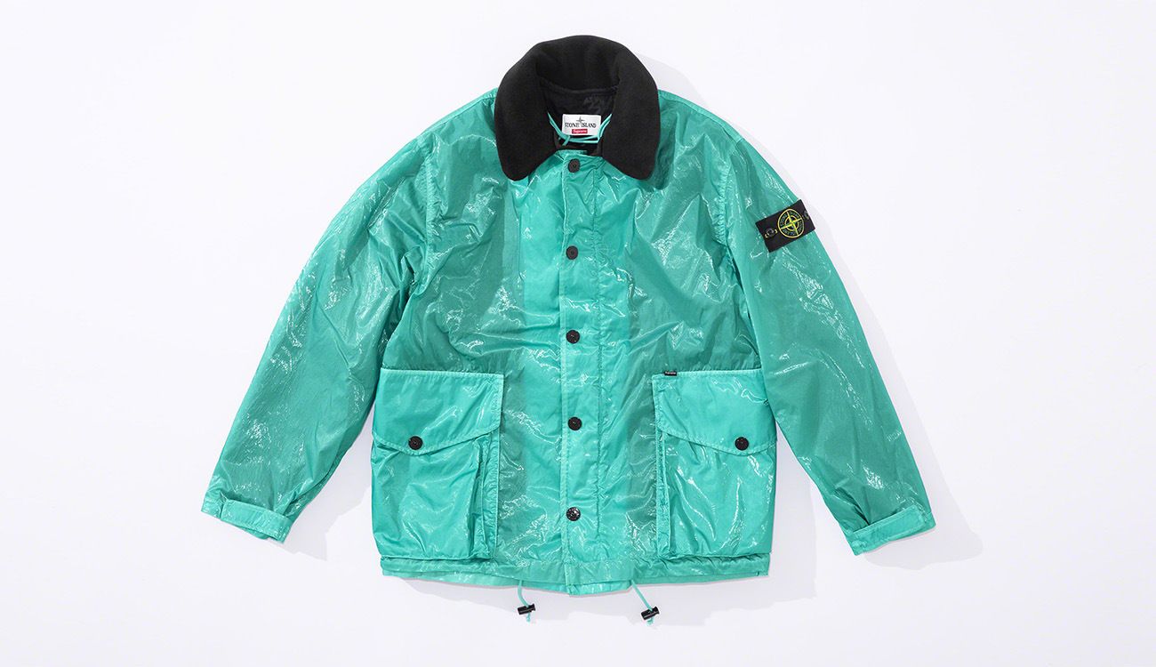 Aquamarine colored jacket in New Silk Light fabric with a black collar, large, bellows pockets and snap closure.