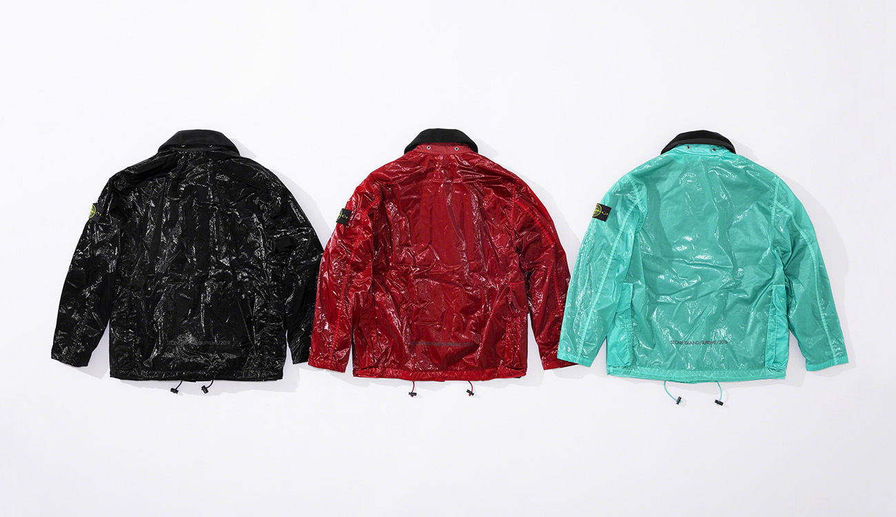 Back of three jackets in New Silk Light fabric, one black, one red and one aquamarine.