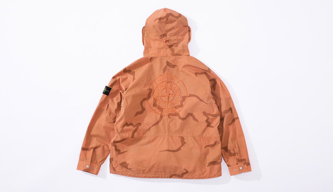 Back of orange camouflage jacket showing the Stone Island compass rose logo embroidery.