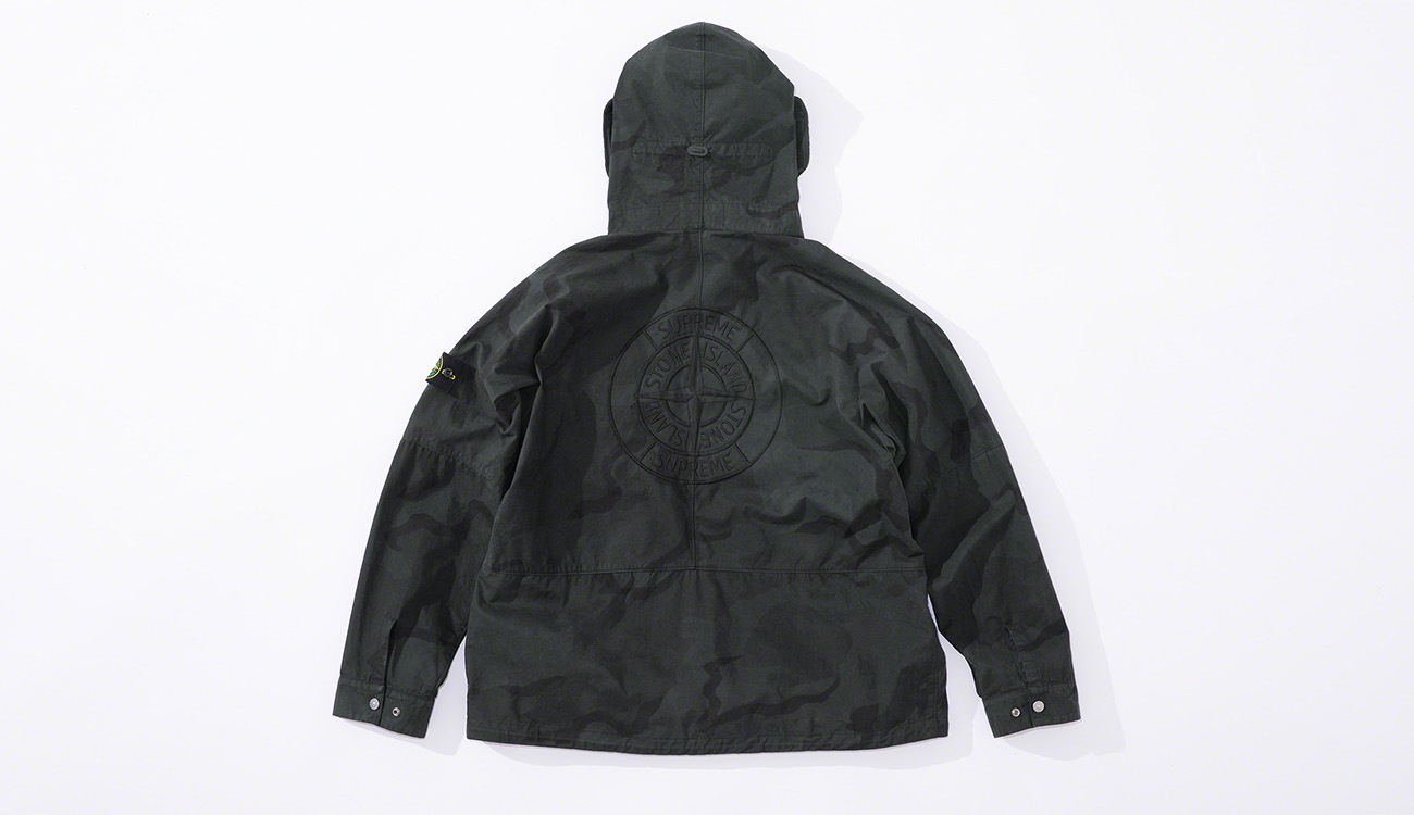 Back of black jacket showing the Stone Island compass rose embroidery.