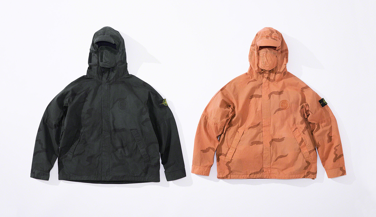 Two jackets in brushed cotton canvas with a camouflage print, one black, one orange.