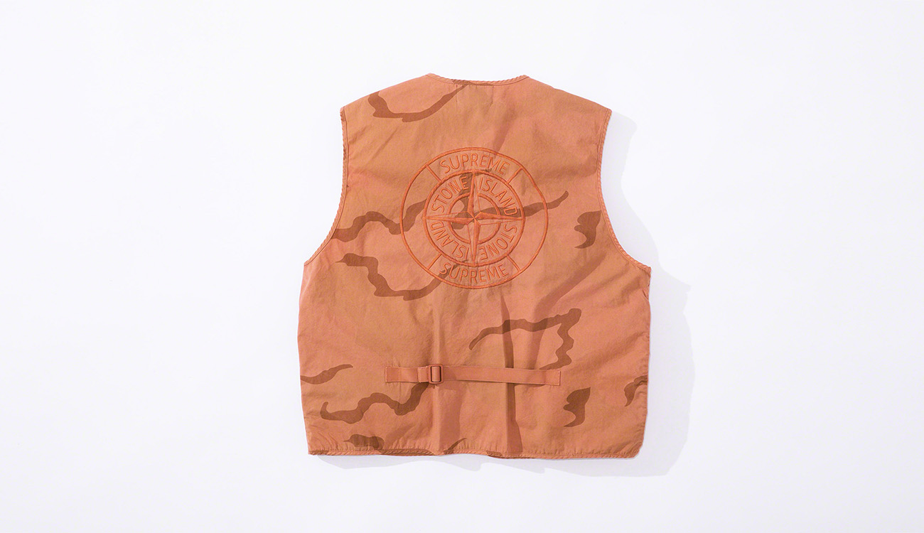 Back of orange vest showing the Stone Island Supreme PIN embroidery.
