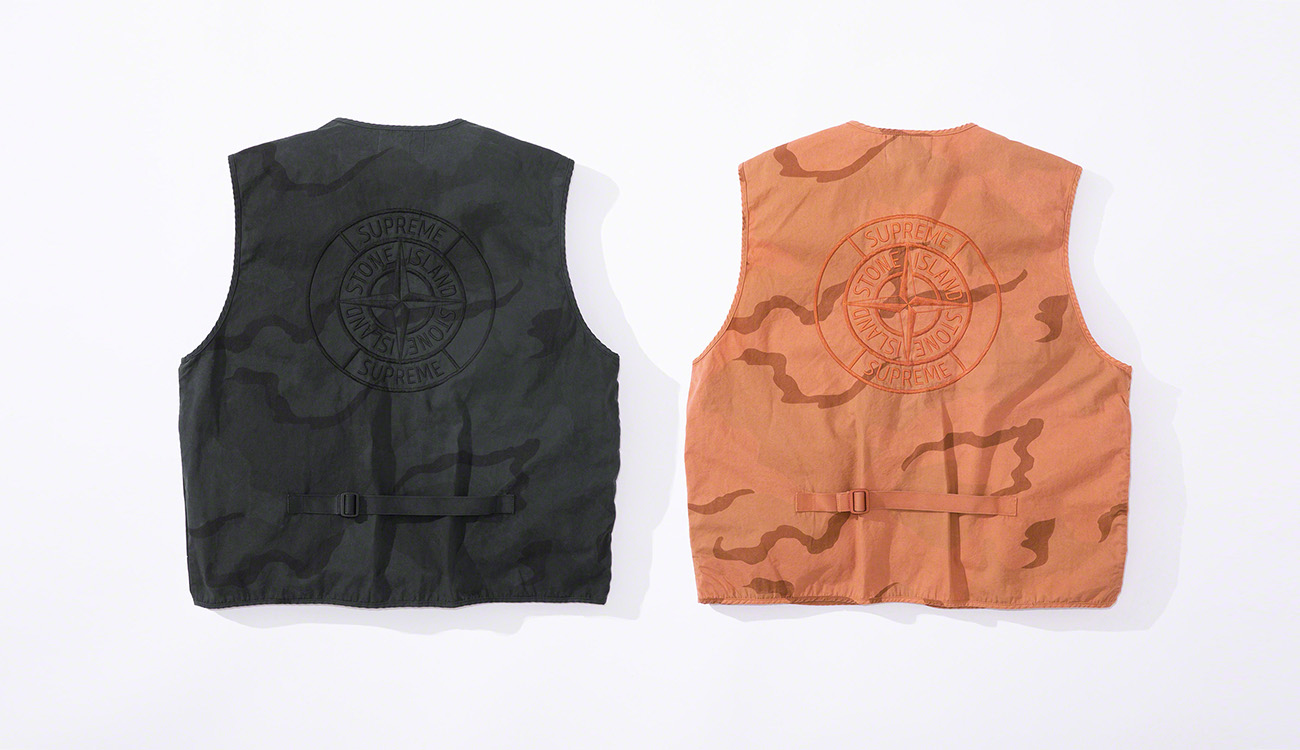 Back of two vests in brushed cotton canvas with a camouflage print, one in black, one in orange.