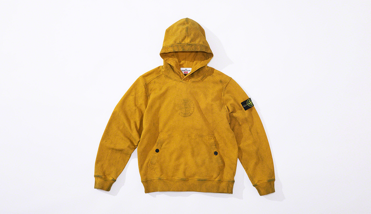 Yellow, hooded sweatshirt with a pouch pocket and the Stone Island Supreme PIN embroidery on the chest.