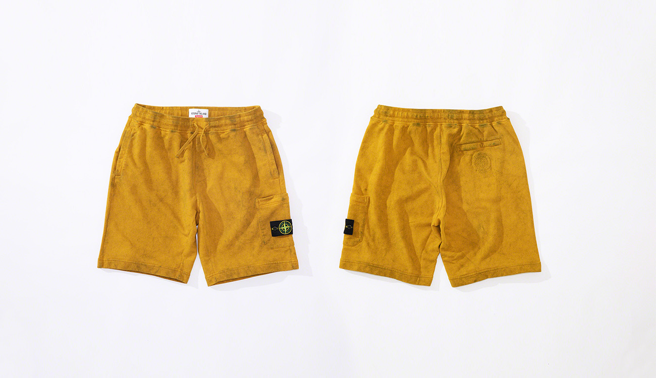 Front and back views of yellow bermuda shorts in cotton fleece fabric with the Stone Island badge on the left thigh.