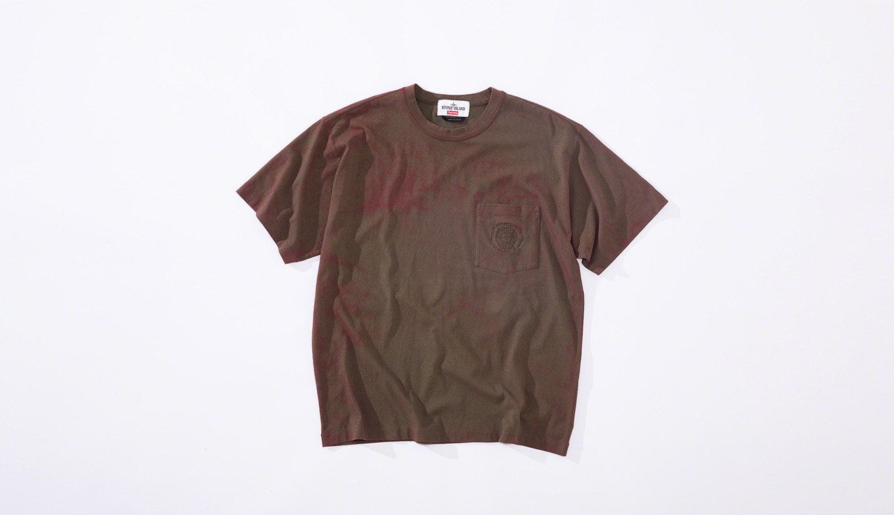 Faded red short sleeved T shirt in cotton jersey with pocket on left chest with the Stone Island Supreme PIN embroidery.