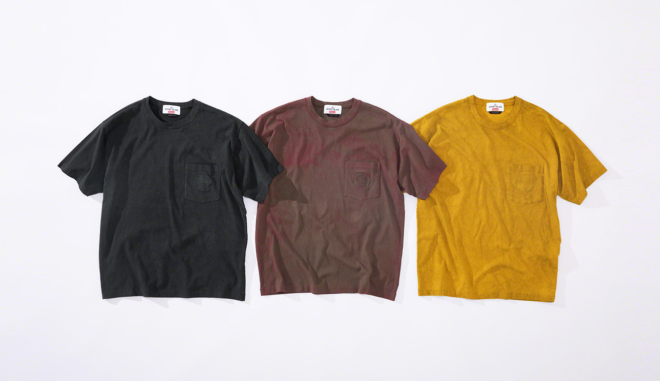 Three T shirts, one black, one faded red and one yellow.