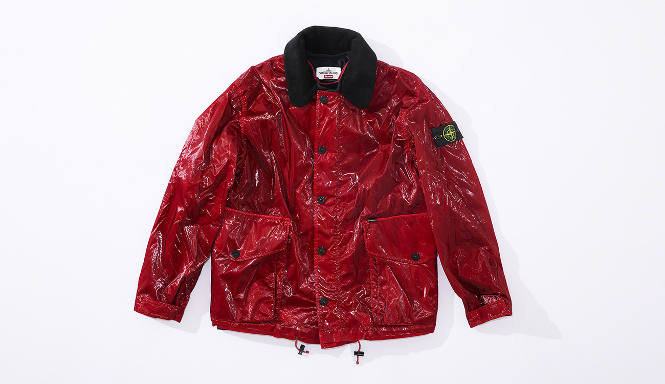 Red jacket in New Silk Light fabric with a black collar, bellows hand pockets and snap closure.