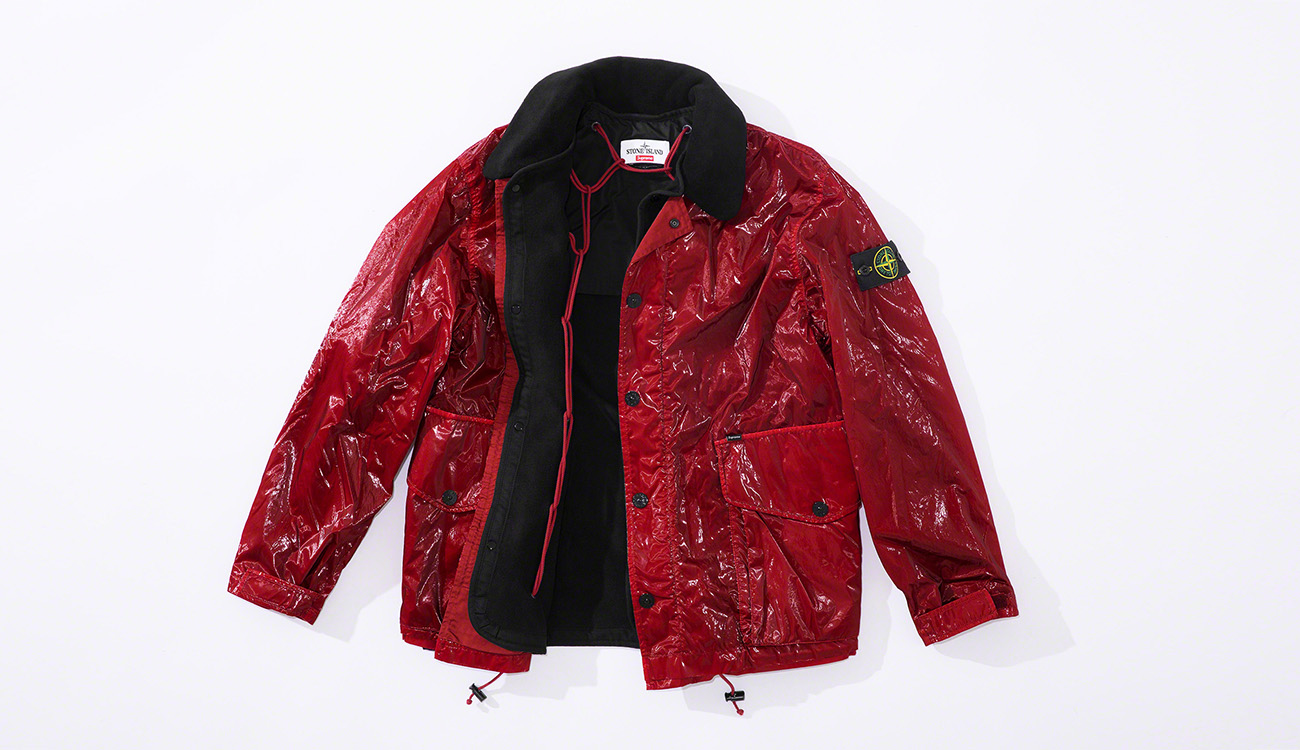 Red jacket in New Silk Light fabric showing detachable black lining.
