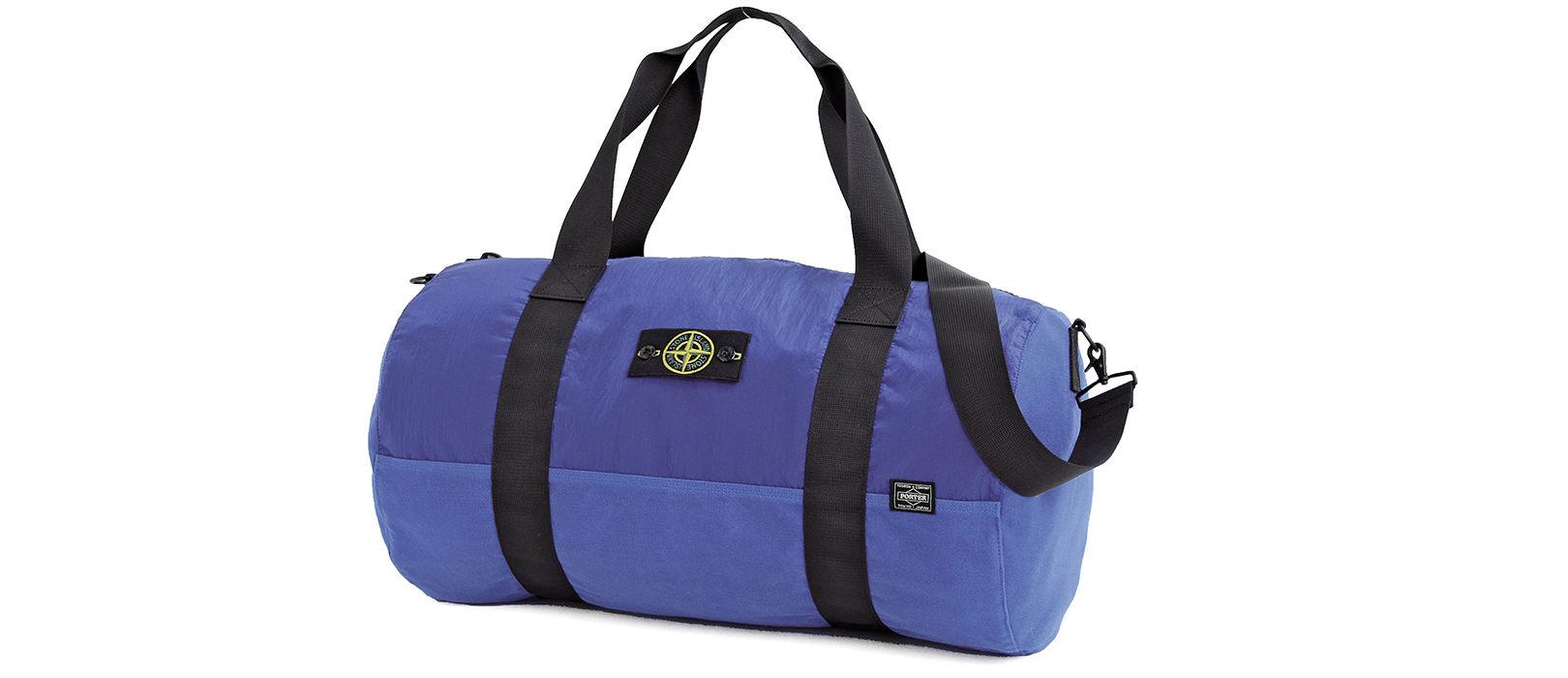 A blue shoulder bag made of Polypropylene Tela and Nylon Metal.