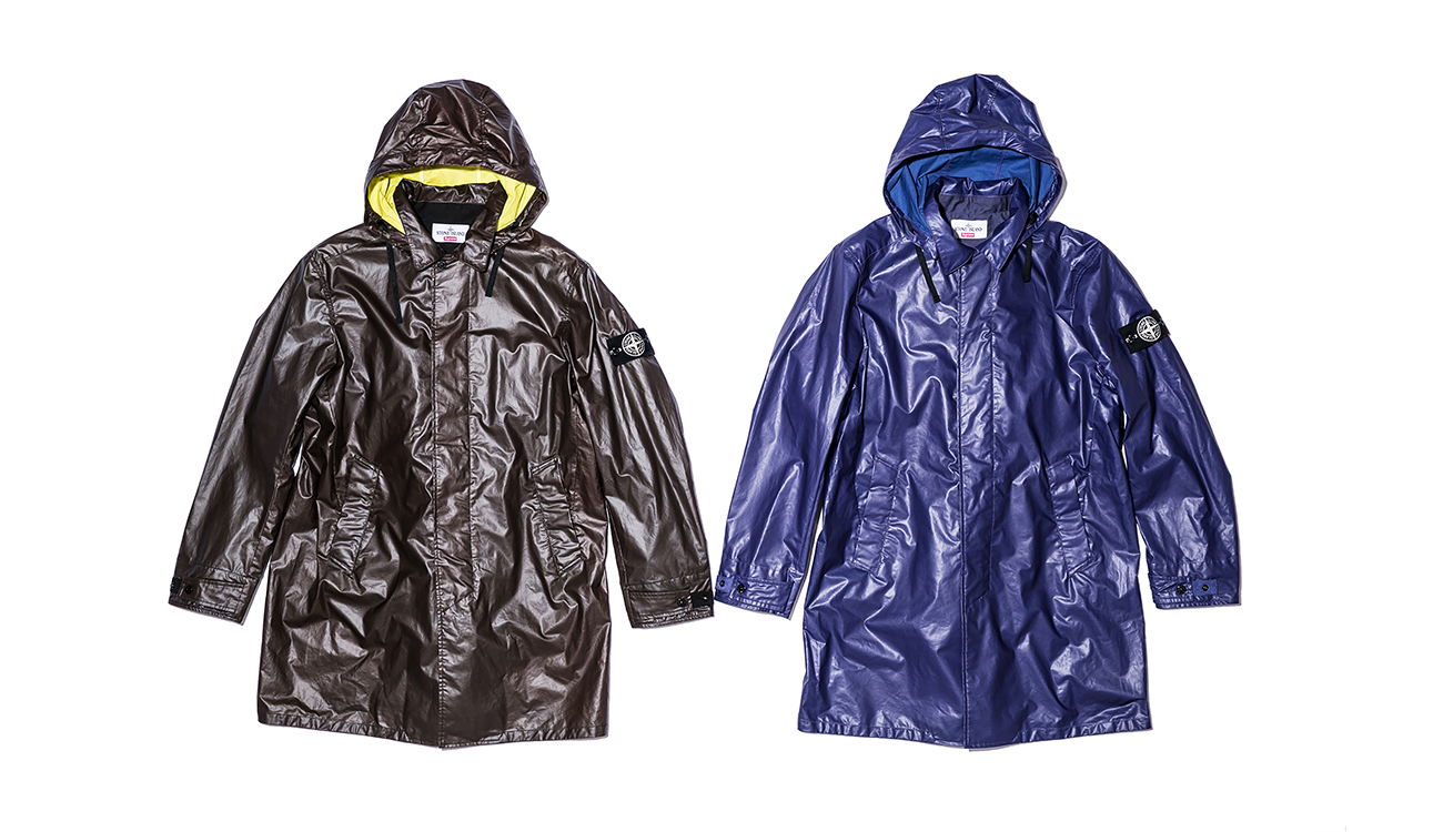 Two trench coats, one brown, one blue, in Heat Reactive fabric.