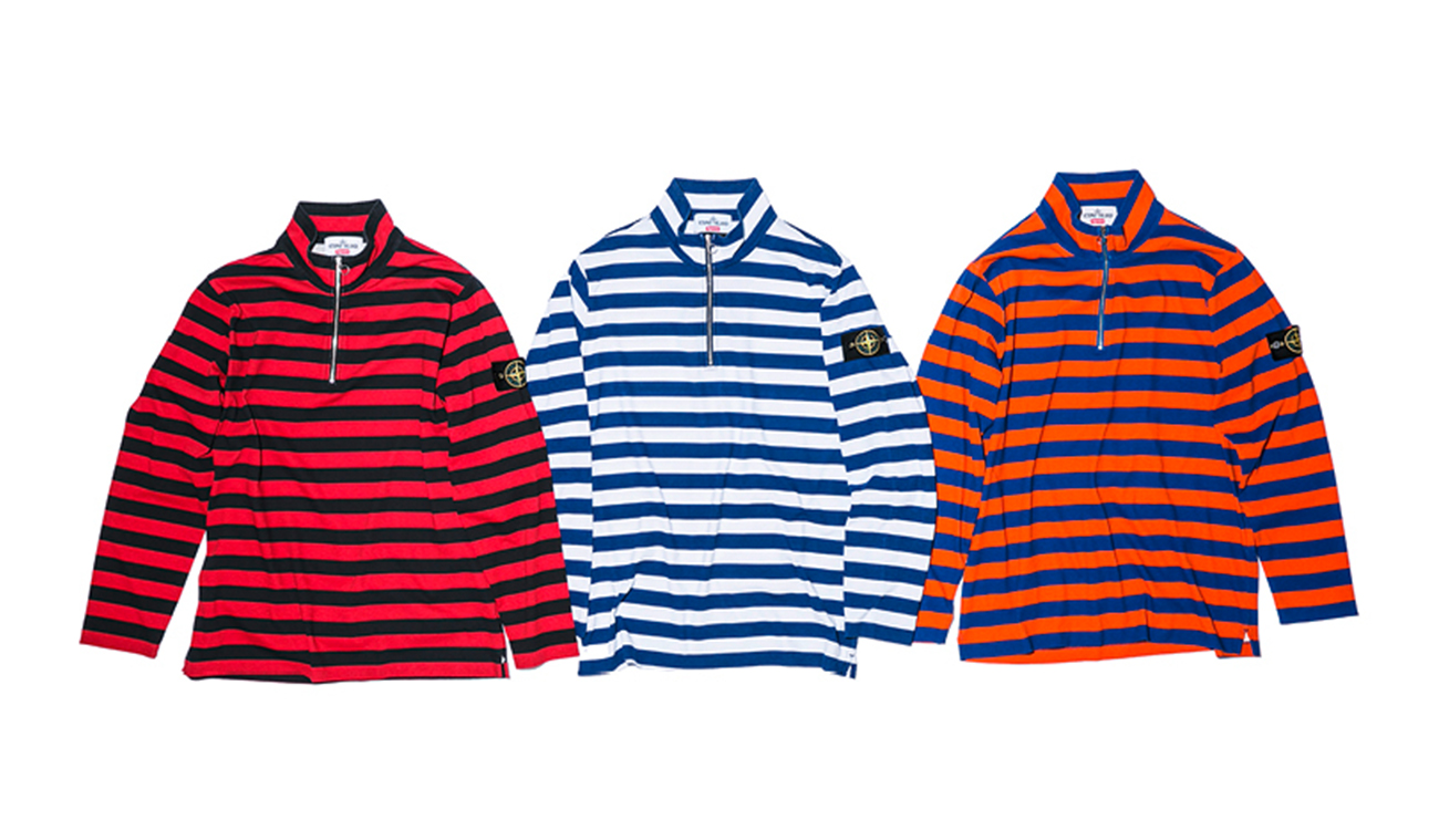 Three striped sweaters in Pima cotton with zip closure at chest, one in black and red, one in blue and white and one in blue and orange.