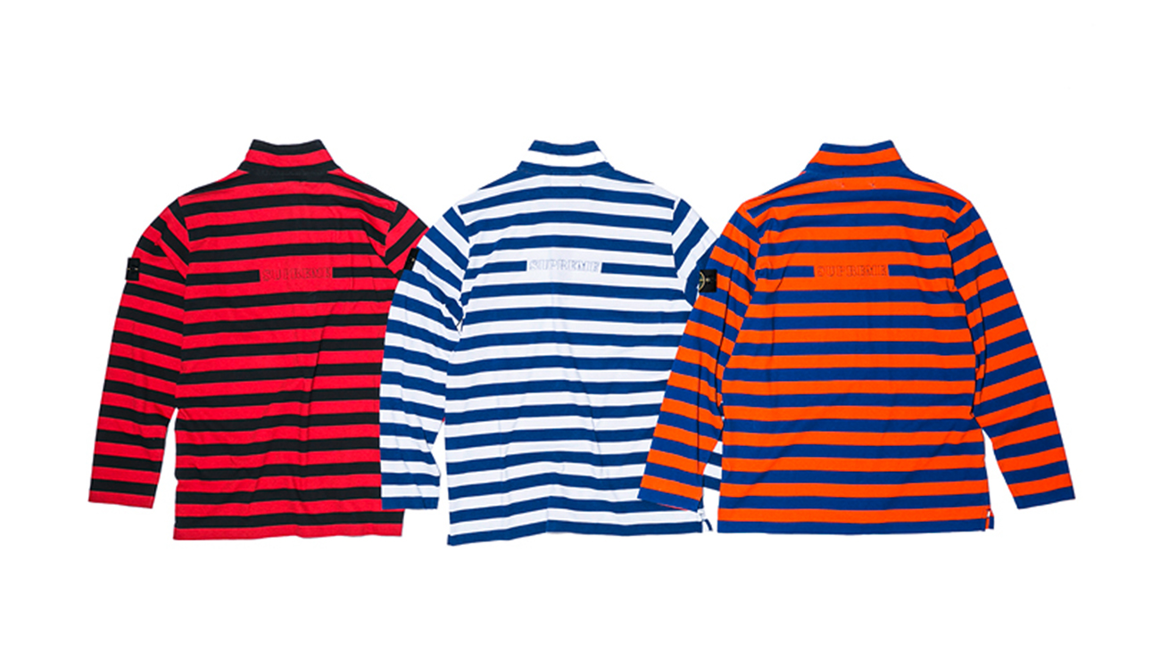 Back of three striped sweaters in Pima cotton with zip closure at chest, one in black and red, one in blue and white and one in blue and orange.