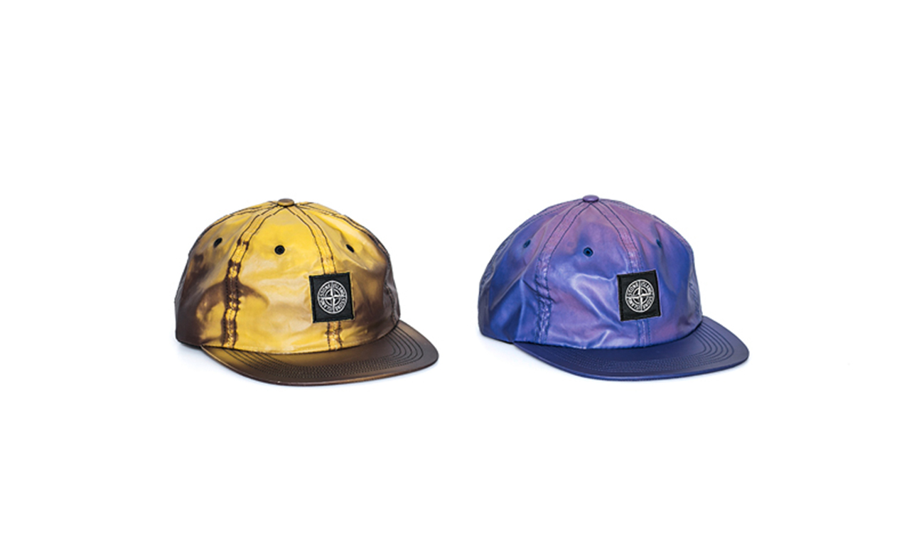 Two baseball caps, one yellow, one blue, in Heat Reactive fabric.