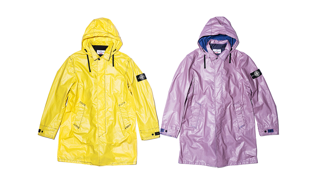 Two trench coats, one yellow, one lilac, in Heat Reactive fabric.
