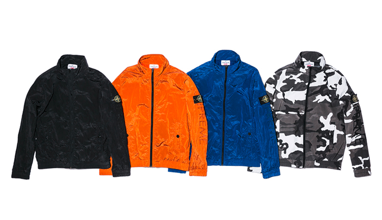 Four tracksuit jackets, one black, one orange, one blue and one camouflage print all in Nylon Metal fabric.