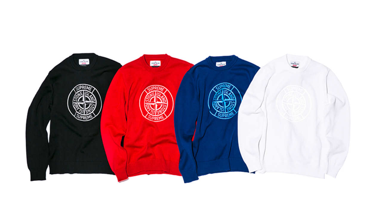 Four crew neck sweaters, one black, one red, one blue and one white all in Nylon Metal fabric and all with the Supreme Stone Island logo print in white.