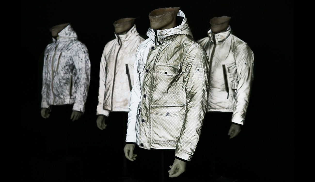Four mannequins in four different jackets all in off white.