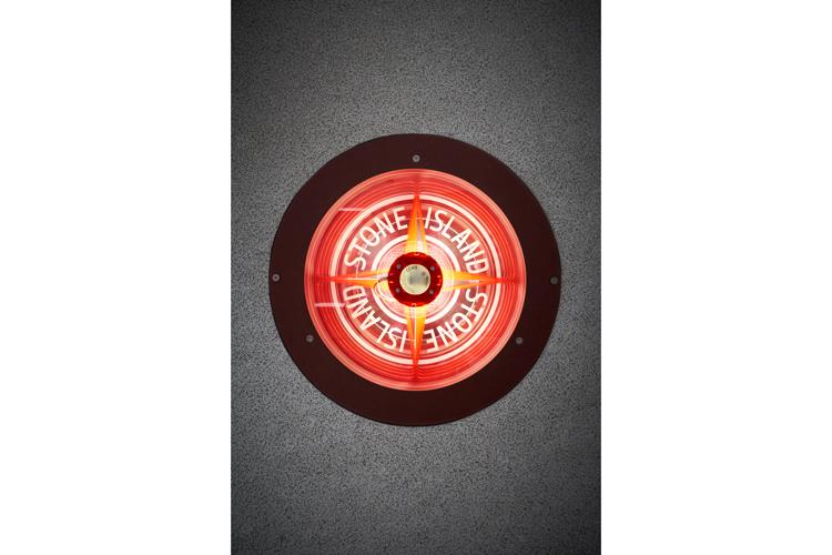 Illuminated Stone Island compass rose logo display