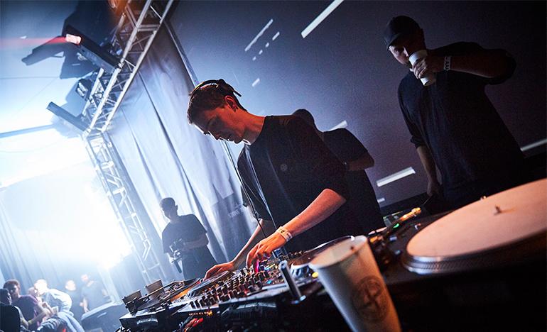 DJ at mixing table.
