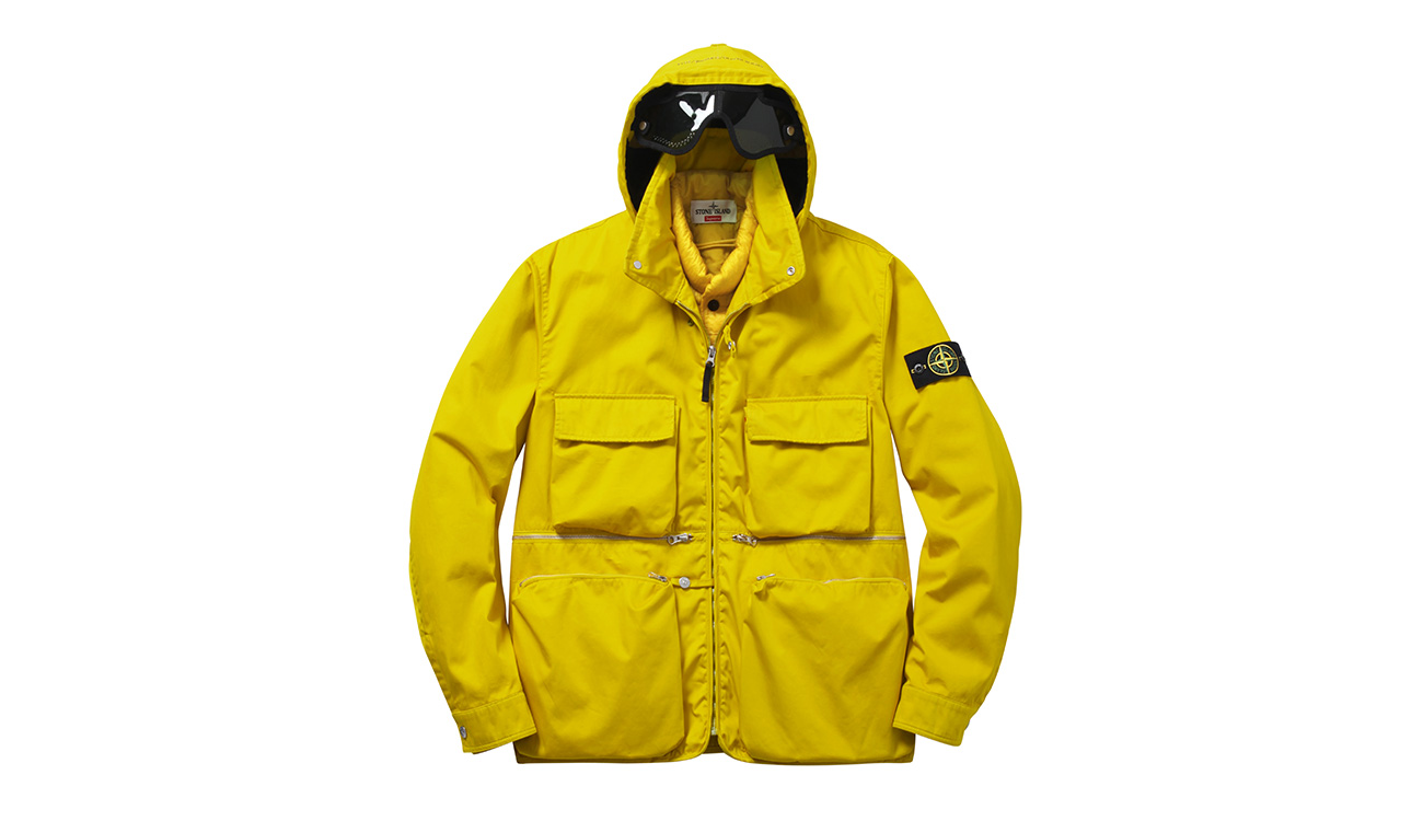 Yellow, hooded jacket with four front pockets, zip closure and attached eye protection.