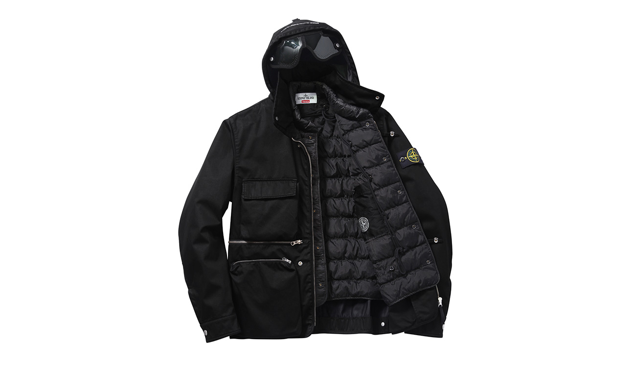Black, hooded jacket with four front pockets and zip closure open to reveal black, quilted lining.
