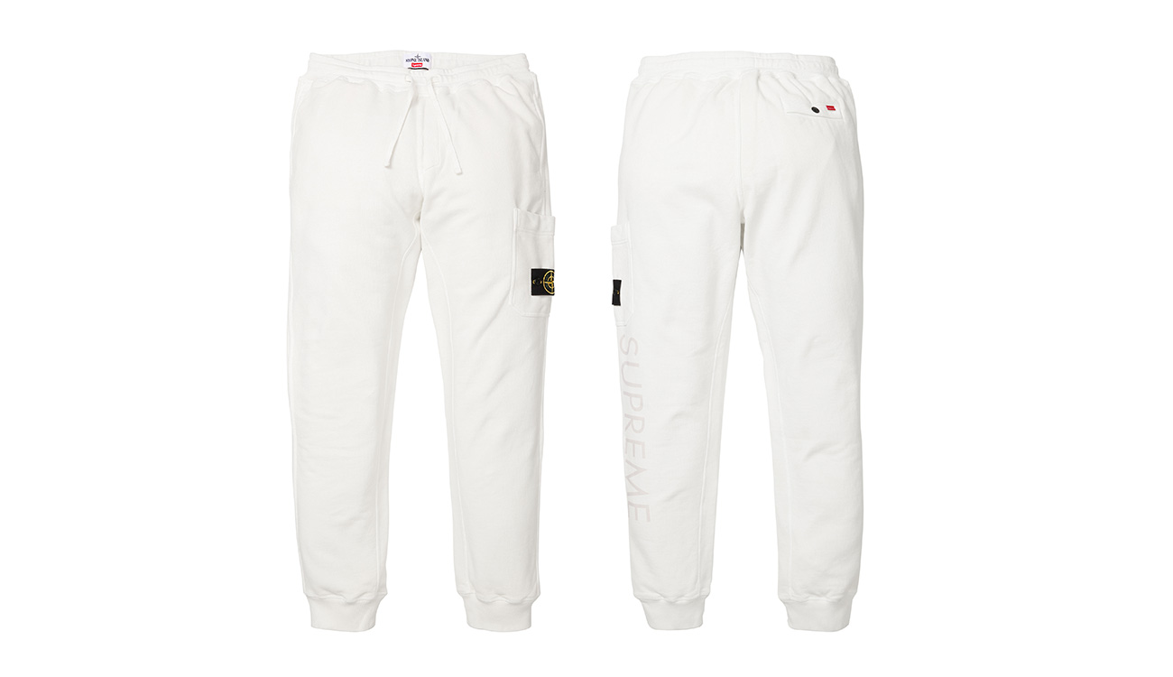 Front side and back side of white sweatpants with Stone Island badge and Supreme written on left leg.