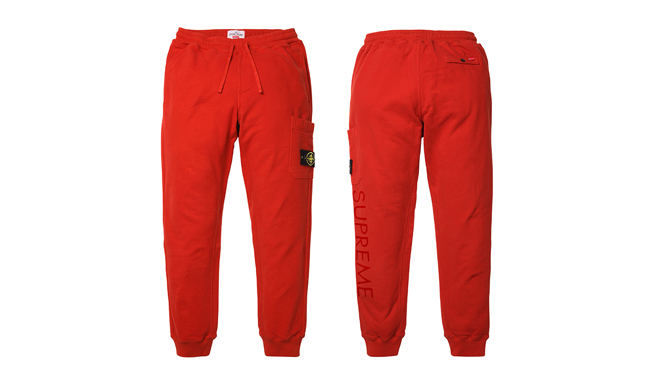 Front side and back side of red sweatpants with Stone Island badge and Supreme written on left leg.