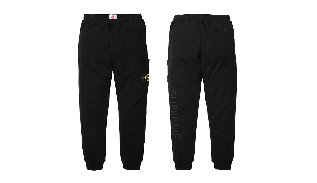 Front side and back side of black sweatpants with Stone Island badge and Supreme written on left leg.