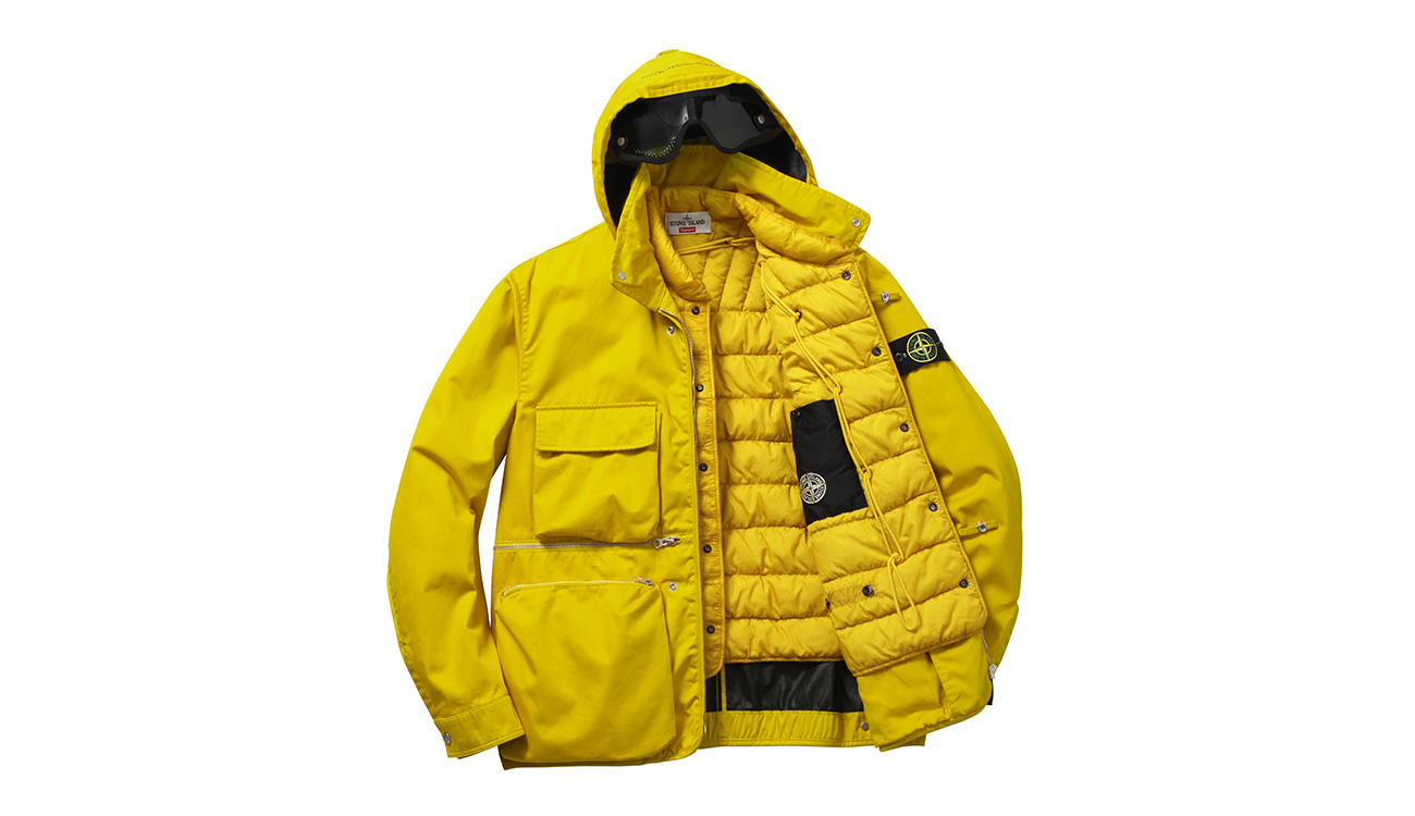 Yellow, hooded jacket with four front pockets and zip closure open to reveal quilted, yellow lining.