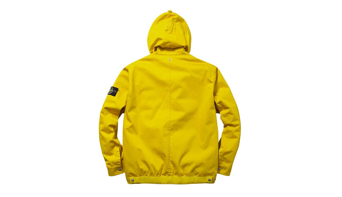 Back of yellow, hooded jacket with Stone Island logo badge on left arm.
