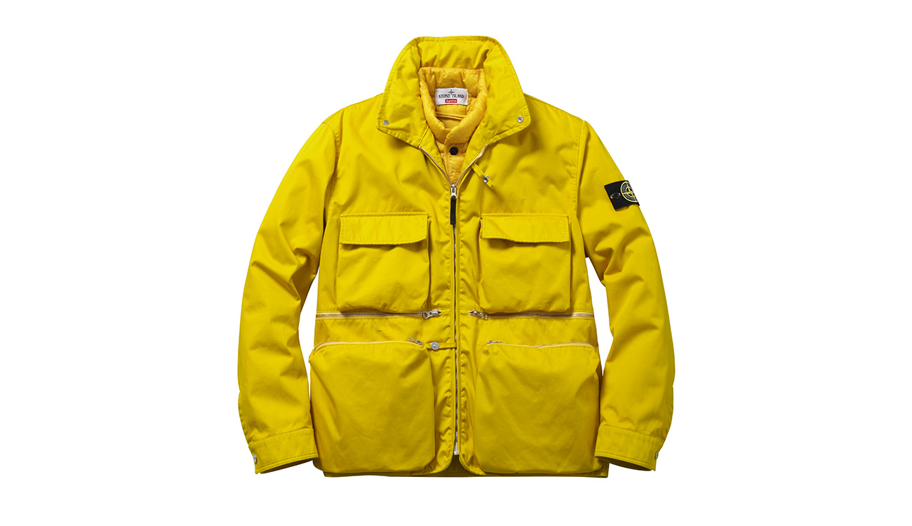 Yellow jacket with four front pockets and zip closure.