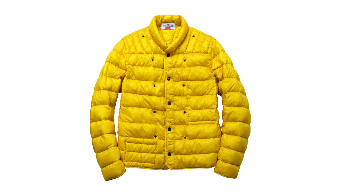 Yellow, quilted jacket with button closure.