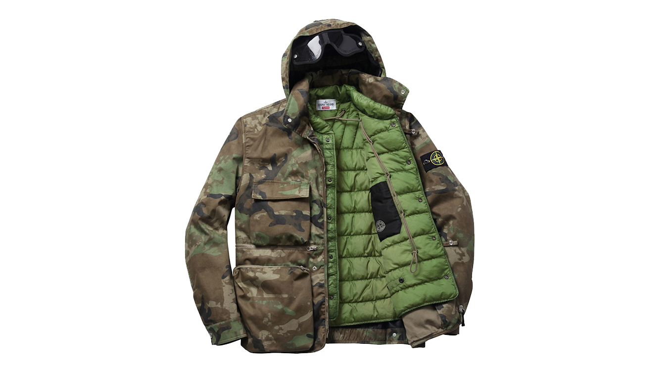 Camouflage jacket with hood, four front pockets and zip closure open to reveal green, quilted lining.