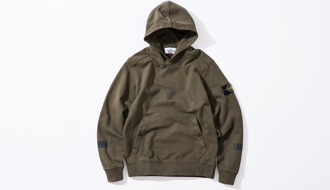 Front of green hoodie in cotton fleece fabric.