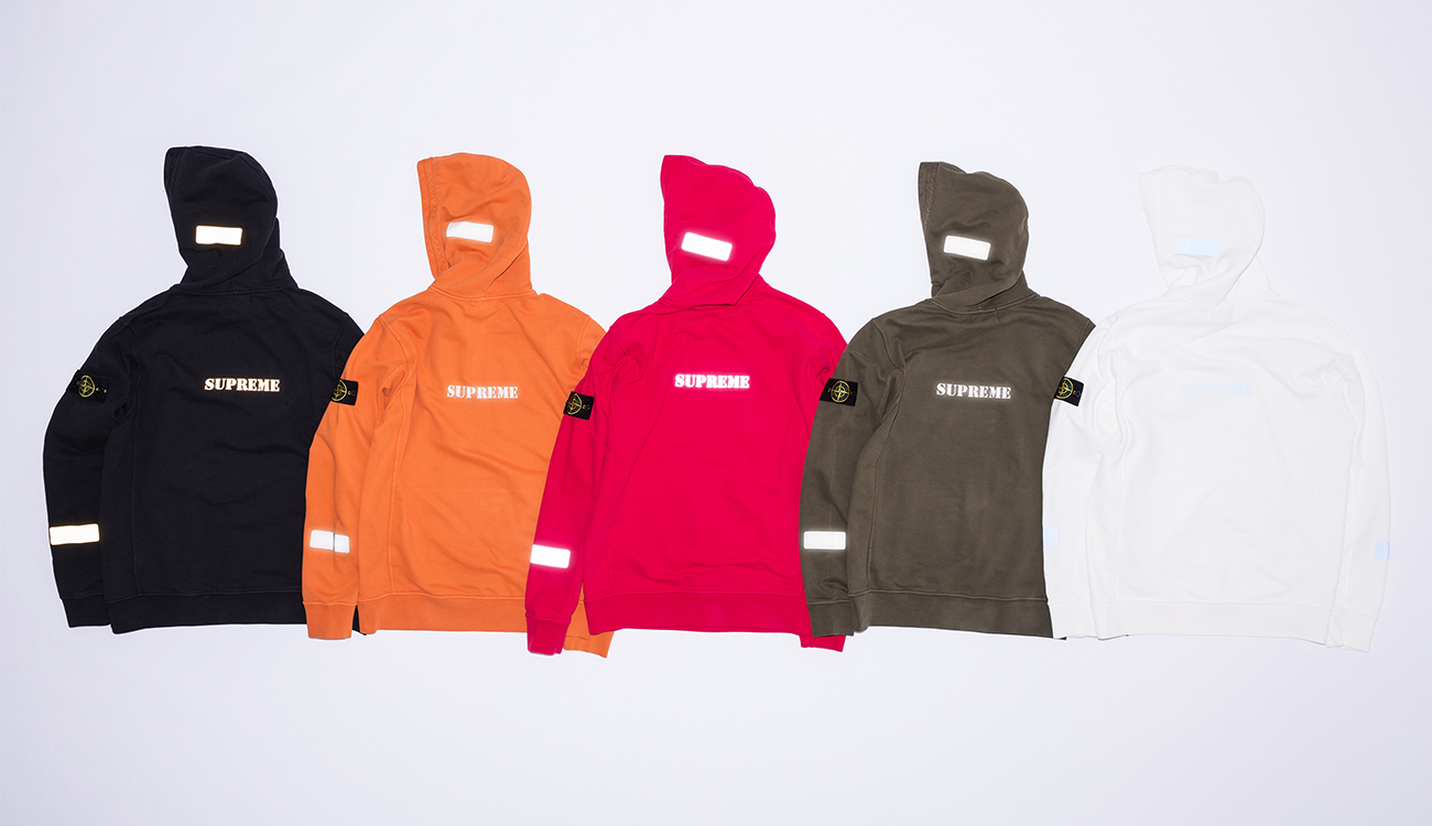 Reflective transfer patches on the hoods and sleeves and the reflective word Supreme on the back of five different colored hoodies.
