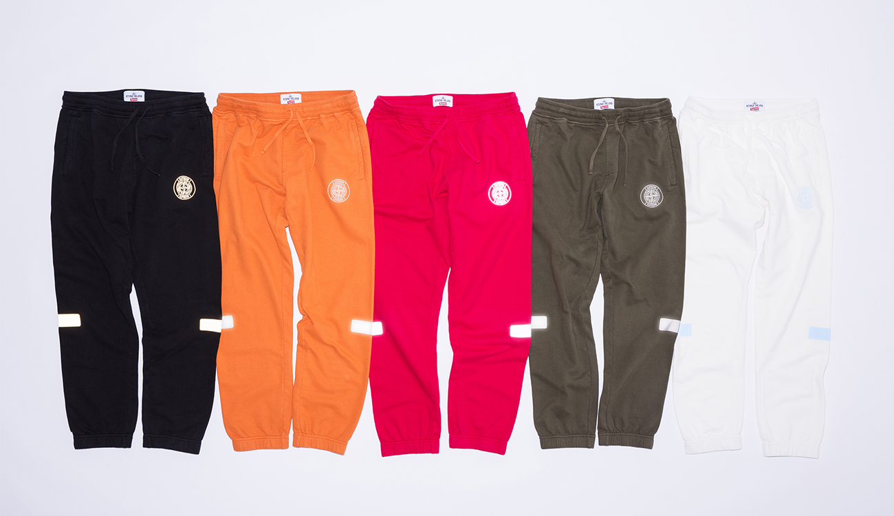 Reflective transfer patches on both knees on five different colored tracksuit bottoms.