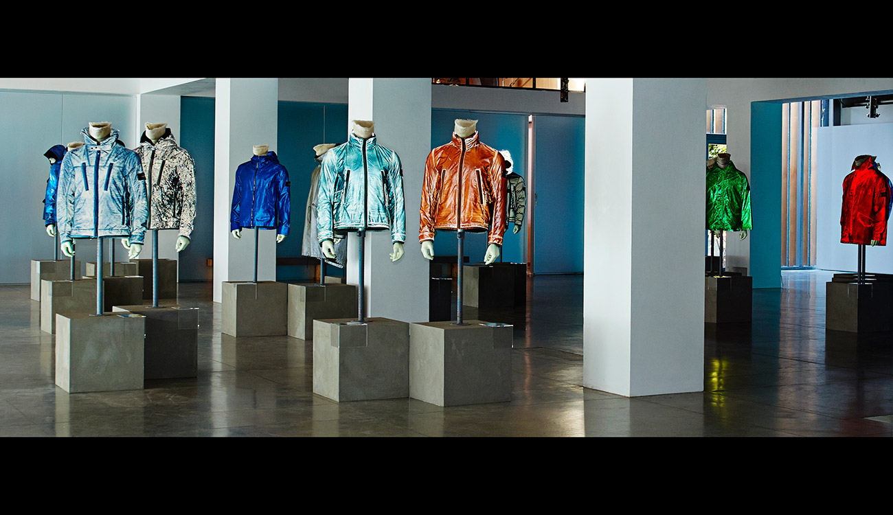 Lots of mannequins in different colored shiny jackets.