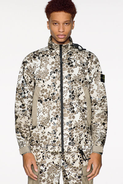 446E1 Model wearing jacket and pants in Light Cotton-Nylon Rep fabric with Alligator Camouflage print.