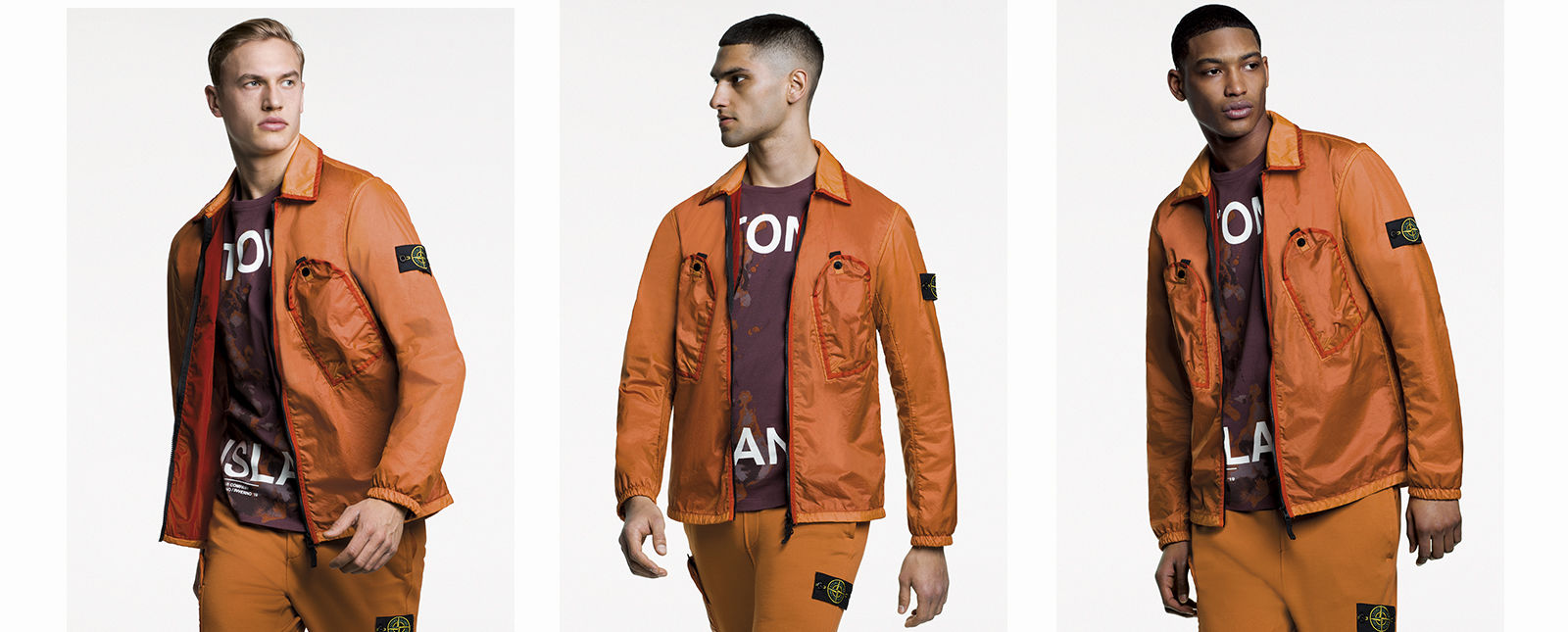 Model wearing shiny, two tone orange overshirt with diagonal pockets at chest and zipper fastening.